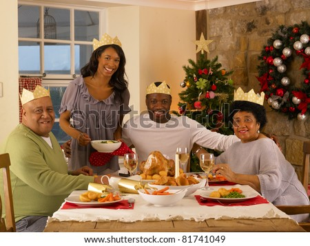 Adult African American family having Christmas dinner