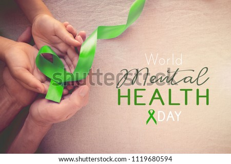 Adult and child hands holding Lime GreenRibbon, world Mental health day #1119680594