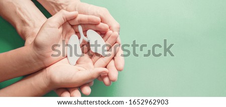Adult and child hands holding lung, world tuberculosis day, world no tobacco day, lung cancer,  Pulmonary hypertension, Pneumonia, copd, eco air pollution,organ donation, respiratory and chest concept Stock photo ©