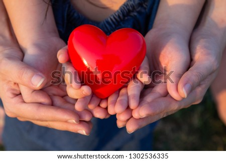 adult and child hands holding red heart, health care love, give, hope and family concept, #1302536335