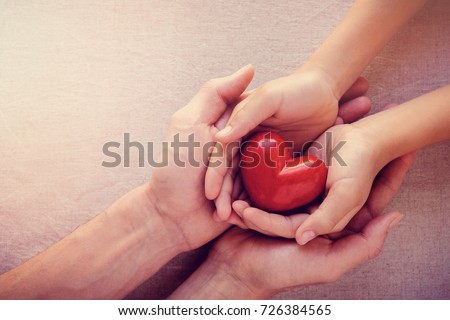 adult and child hands holding red heart, health care love, give, hope and family concept, world heart day,world health day - Shutterstock ID 726384565