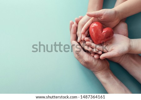 adult and child hands holding red heart, heart health, donation, happy volunteer charity, CSR social responsibility concept, world heart day, world health day, world mental health day, family day #1487364161