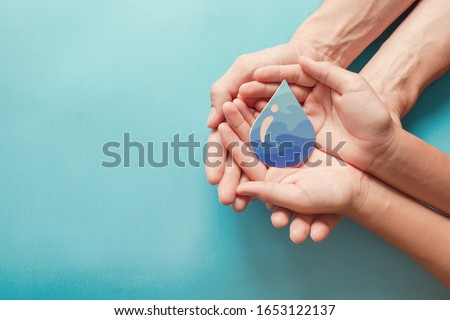 Adult and child hands holding water drop,world water day,clean water  sanitation,hand sanitizer and hygiene for coronavirus pandemic,family washing hands,CSR,save water, World Oceans Day concept