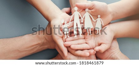 Adult and children hands holding paper family cutout, family home, foster care, homeless charity support concept, family mental health, international day of families