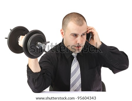 stock photo : Adult business man on the phone doing fitness at work.