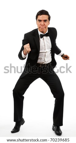 Adult business man prepared to fight clench his teeth to grimace on his face, wearing formal costume