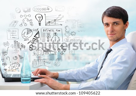 Adult business man sitting at his office and planning his business future