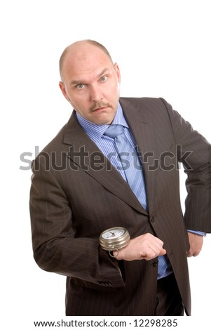 Adult businessman looking very shocked at the huge watch on his wrist - stock photo