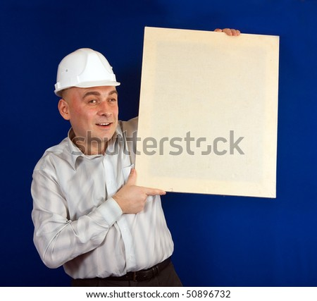 Adult construction worker in white shirt and hard hat on a blue background