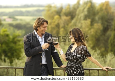 Adult couple celebrating with red wine