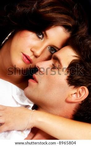 adult couple faces portrait over a black background