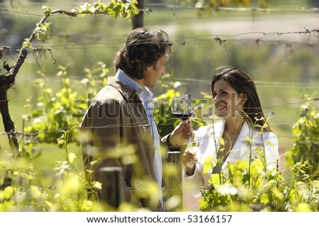 Adult couple in a vineyard
