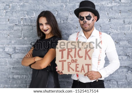 Adult couple ready for halloween
