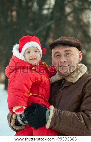 Adult dad and cute baby-daughter in winter