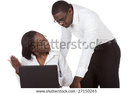 adult education of Ethnic black Afro American man and woman in glasses by laptop taking, discussing and solving problem trying to figure out some stuff - stock photo