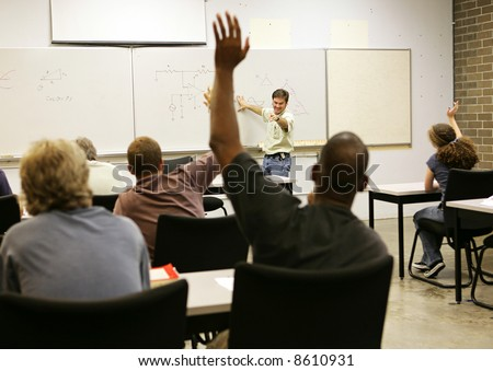 Adult education teacher in front of his class.