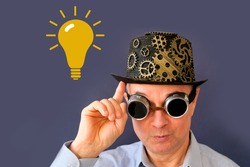 adult elderly man in a hat and black glasses in the style of steampunk, parapunk, emotions on the face, yellow symbol light bulb, concept idea, eureka