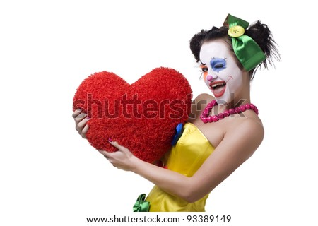 Adult female clown holding red heart