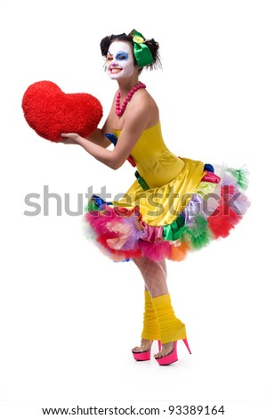 stock photo : Adult female clown holding red heart