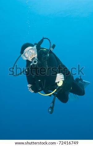 Adult female scuba diver in the blue. Tower, Sharm el Sheikh, Red Sea, Egypt.