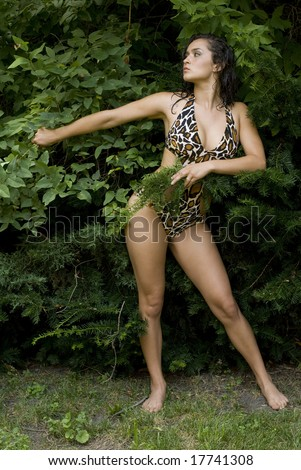 Adult female wearing an animal print bathing suit with no shoes
