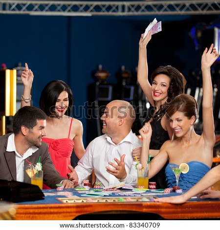 adult group celebrating friend winning blackjack