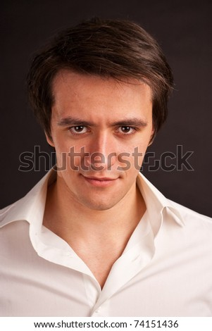 It's Never too Late Stock-photo-adult-guy-in-the-white-shirt-on-a-black-background-74151436