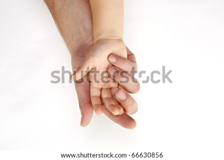 Adult hand hold kid's handful