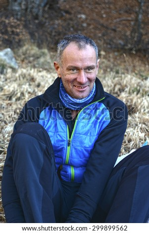 Adult hiker resting after a long journey into the wilderness