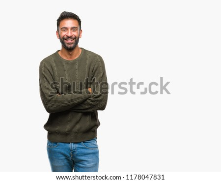 Adult hispanic man wearing winter sweater over isolated background happy face smiling with crossed arms looking at the camera. Positive person.