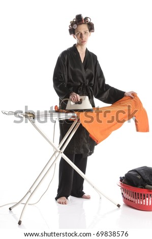 stock photo adult housewife wearing a black robe and curlers in her hair makes ironing with an iron and ironing 69838576 sported a tiny bikini and