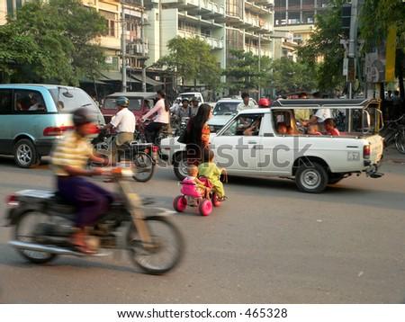 Adult & Kids crossing junction. 1of4. Mandalay, Myanmar, (Burma)