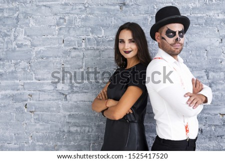 Adult male and woman dressed for halloween