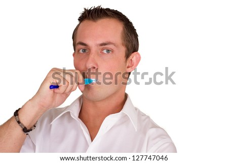 adult male brushing his teeth isolated on a white background, closeup picture