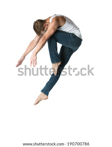Adult male dancer wearing a white shirt and jeans. Image is isolated on a white background. - Shutterstock ID 190700786