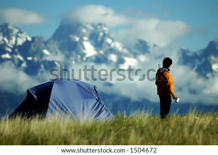 adult male gazing at stunning mountain vista