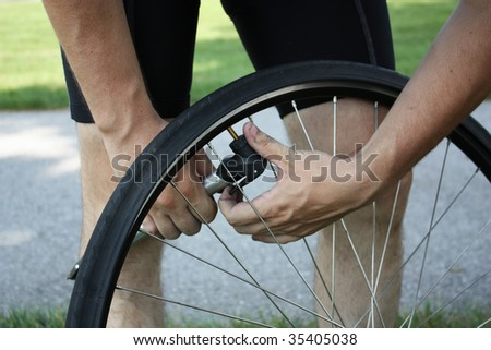 Adult male inflating tire