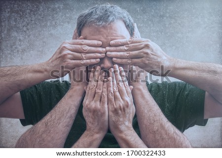 "Photo of  Adult male photographic representation of the principle ""see no evil, hear no evil, speak no evil"" with hands over eyes, mouth, and ears. A composite photograph. Conceptual."