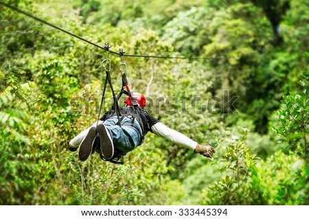 Adult Male Tourist Wearing Casual Clothing On Zip Line Or Canopy Experience In Ecuadorian Rain Forest  #333445394
