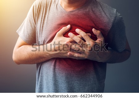 Adult male with heart attack or heart burn condition, health and medicine concept #662344906