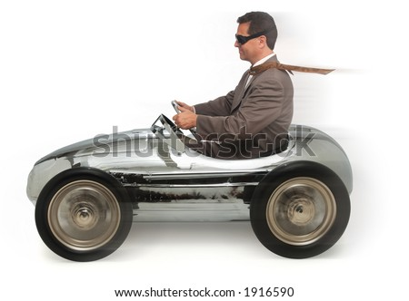 adult man in child's pedal car on white background