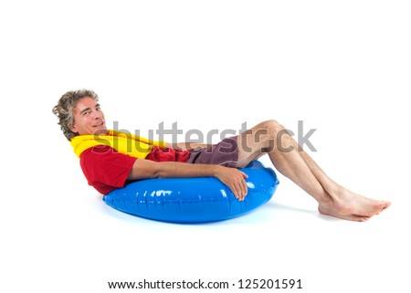Adult man is sitting on a float