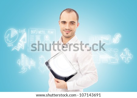 Adult man planning and working using his tablet computer