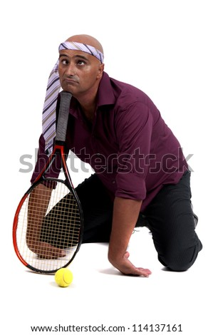 adult man playing tennis