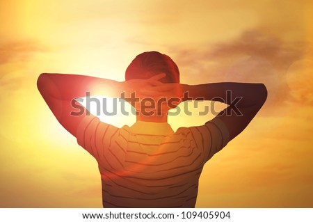 stock photo : Adult man satisfied with nature beauty of sunset.