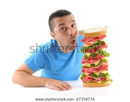 Adult man taking a bite from a big sandwich isolated on white background.