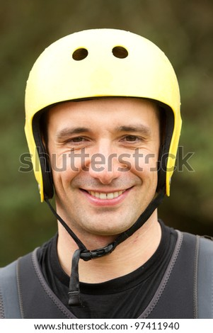 stock photo : Adult man wearing typical water sport outfit