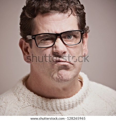 Adult man with funny upset expression closeup