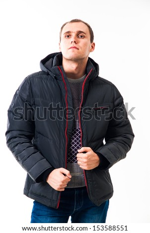 Adult man with winter clothes standing on white background. Man stands in a winter jacket isolated on white background. Casual cool young guy. Attractive guy in winter clothes.