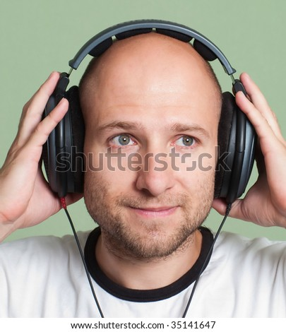 Adult men in sound headphones listening mp3 music
